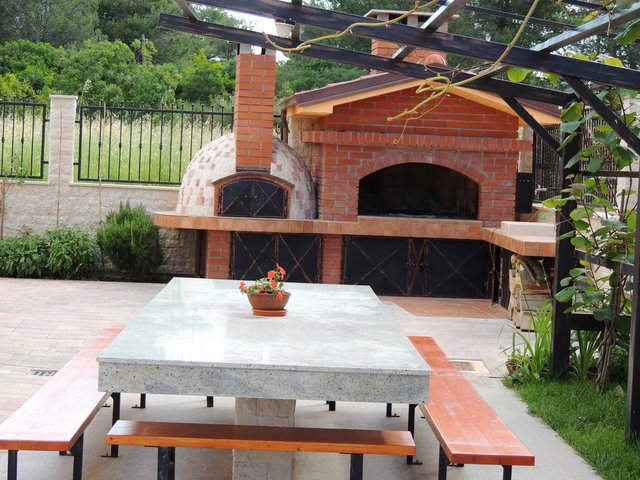 Barbecue and traditional wood-fired brick oven